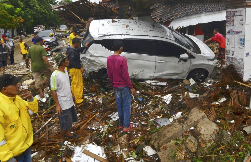 Indonesia's disaster agency says tsunami death toll climbs to 222, with 843 injured and 28 missing