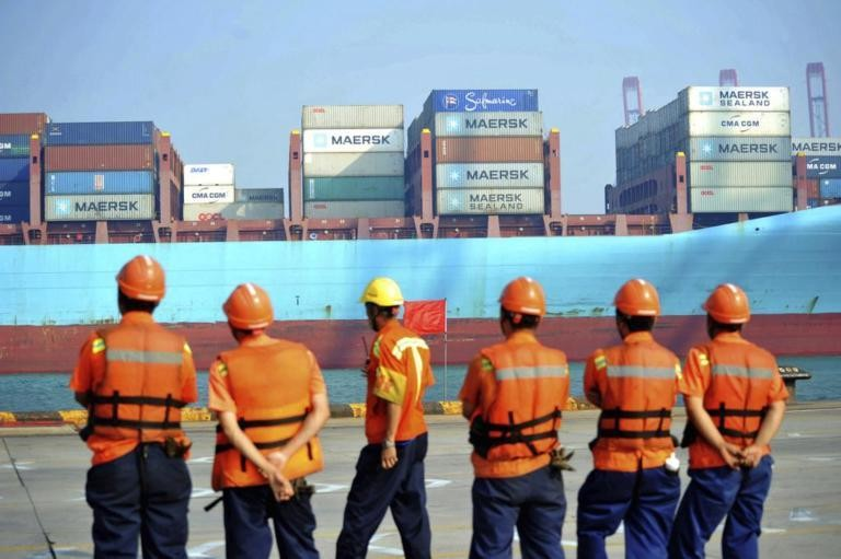 File Photo: Chinese dock workers in Qingdao, July, 2017