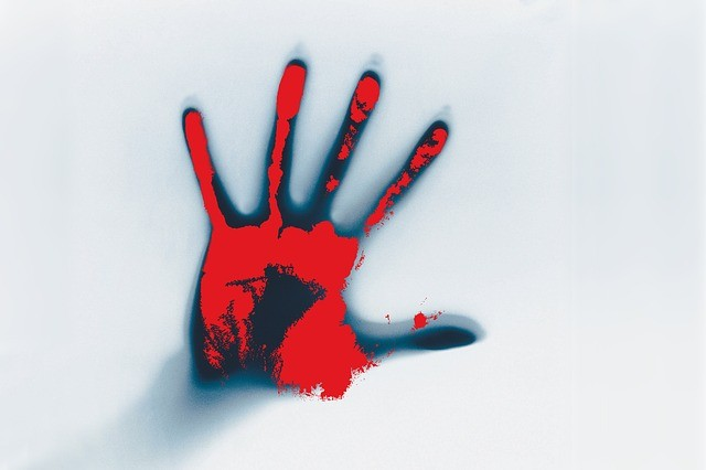 Stock image of a bloody hand. (Image by Pixabay user stux)