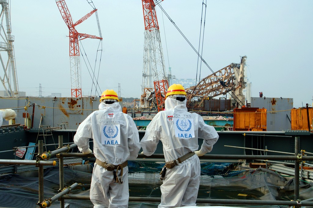 IAEA experts examine wreckage at the disaster site (IAEA/Flickr)