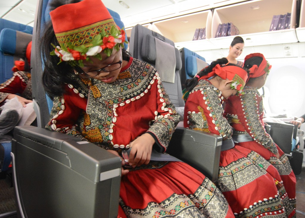 Paiwan children try out the seat belts on the Boeing Dreamliner.