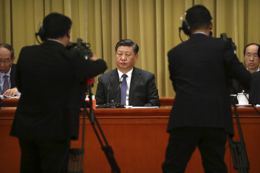 Chinese leader Xi Jinping at his speech Wednesday (center).
