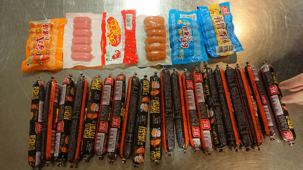 A Chinese and a Taiwanese traveler were each fined NT$200,000 for bringing in meat products Wednesday.