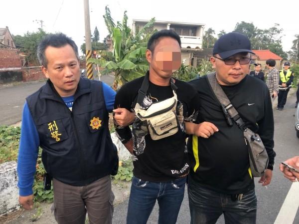 Indonesian suspect (center).