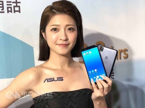 A model shows Zenfone smartphones from ASUS.