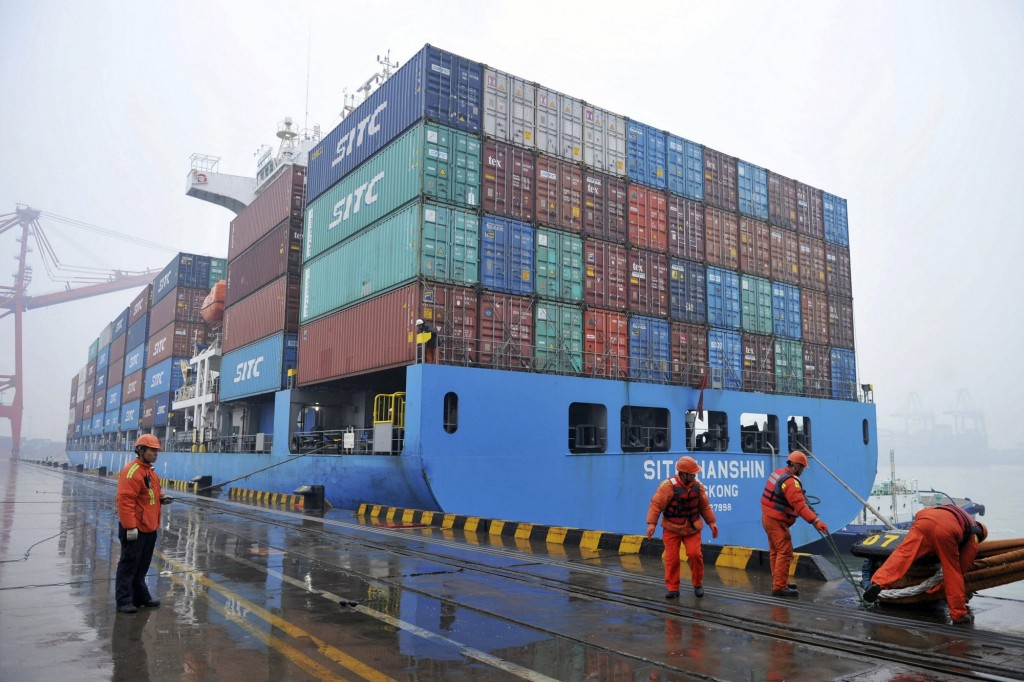 Jan. 11, 2019: workers moor a container ship at a port in Qingdao in east China's Shandong.