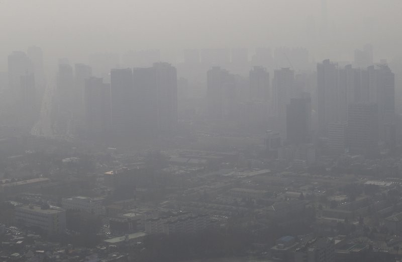 File photo: smog blankets Seoul in 2014