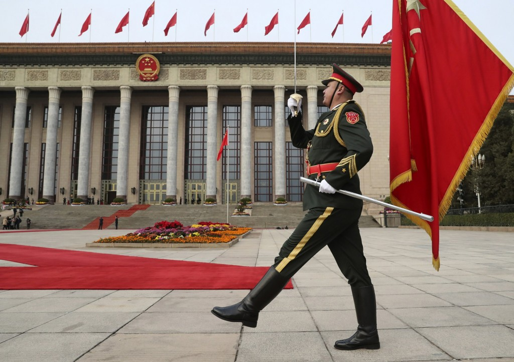 PLA member marching before the Great Hall of the People in Beijing