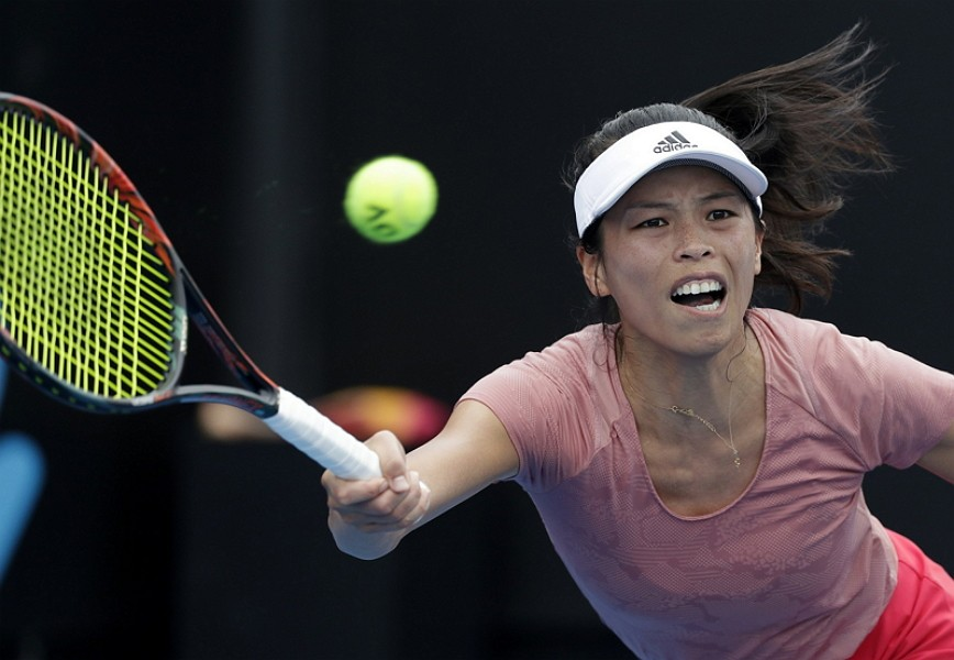 Taiwan's Hsieh Su-Wei makes a forehand return to Germany's Laura Siegemund during their second round match at the Australian Open tennis championships