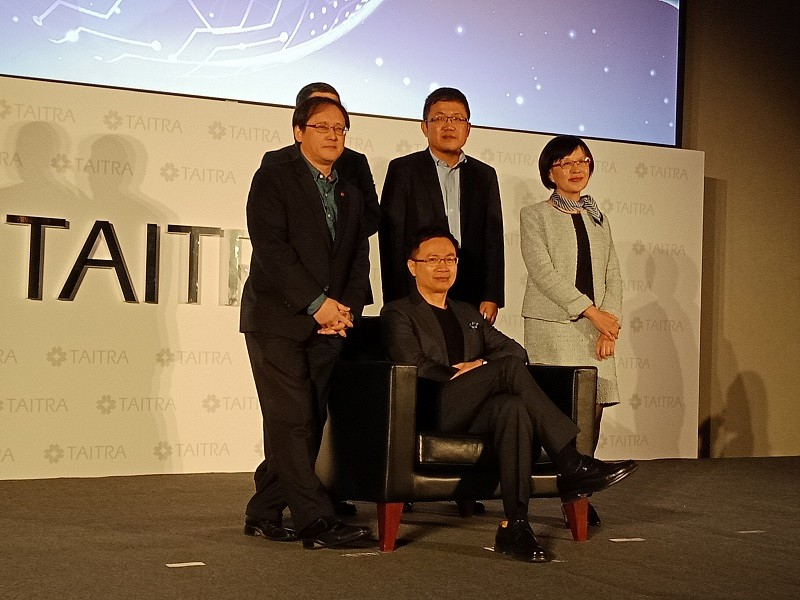 TAITRA chairman James Huang (seated)