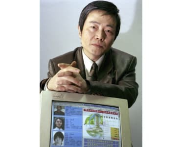 File photo: 2000, Huang Qi off his web site which documented alleged rights abuses