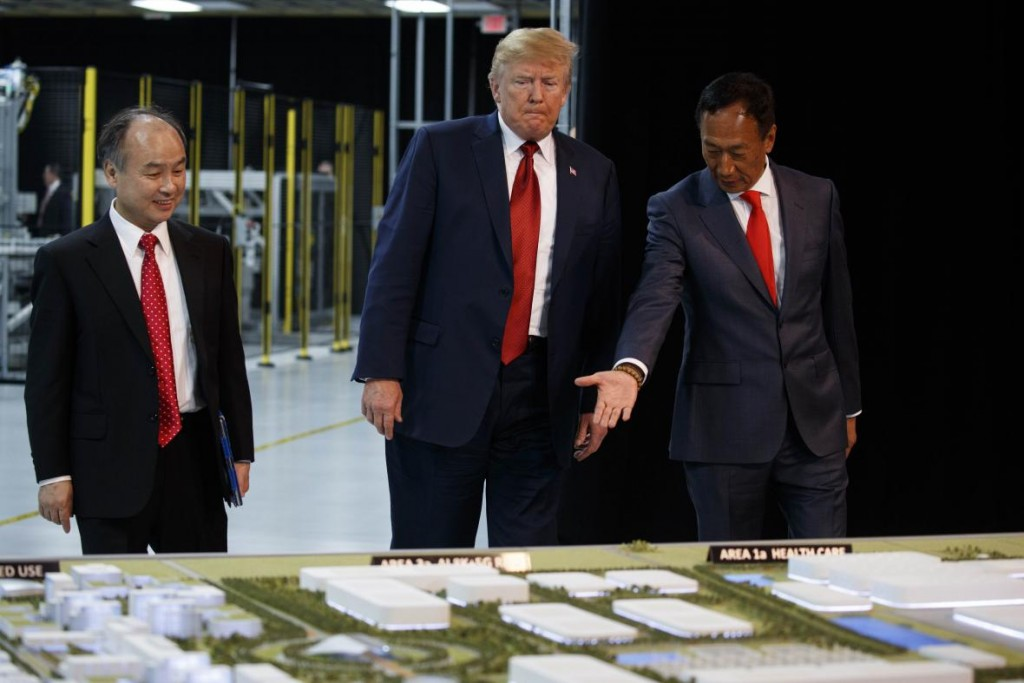 File Photo: Donald Trump and Terry Gou (R) review scale model of Mount Pleasant factory site