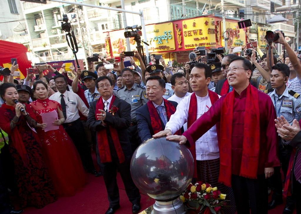 Officials touch a plasma globe in Myanmar
