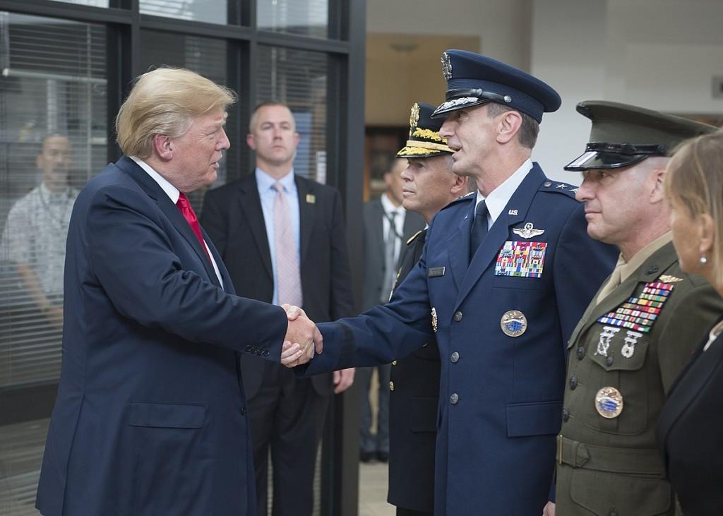 File photo, Nov. 2017: Lt. Gen. Schneider greets Pres. Trump at USPACOM