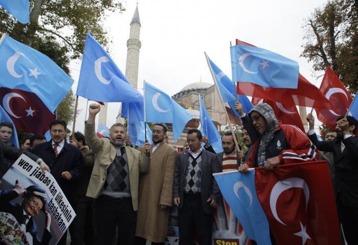 File Photo: Uyghur Turks protesting, waving Turkish and East Turkestan flags