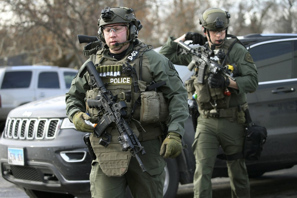 Police officers at the scene where an active shooter was reported in Aurora, Ill., Friday, Feb. 15