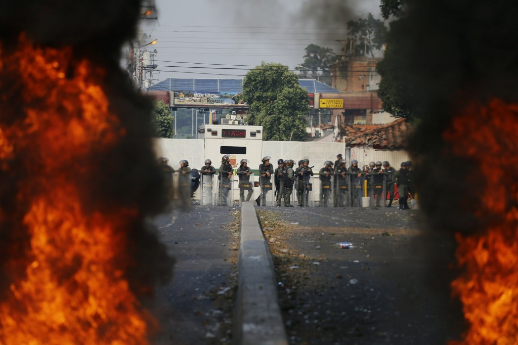 Bolivarian National Guard troops man a barricade on the border with Colombia, Feb. 23