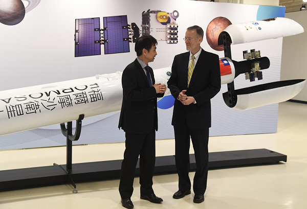 AIT Director Brent Christensen (R) and Nat. Space Organization Director Chun-Liang Lin (L) in front of Formosat rocket