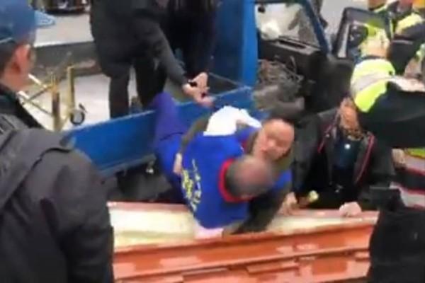 Screenshot of video showing White Wolf falling into casket.
