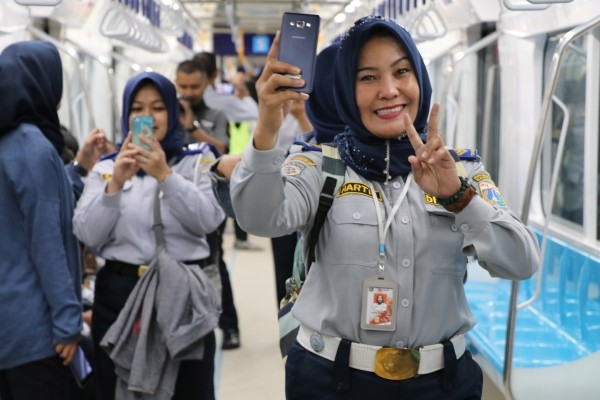 Passengers on trial run of Jakarta MRT.