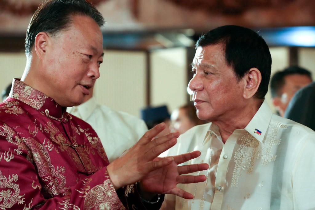 Chinese Ambassador to the Philippines Zhao Jianhua and PHI President Duterte (PNA file photo)