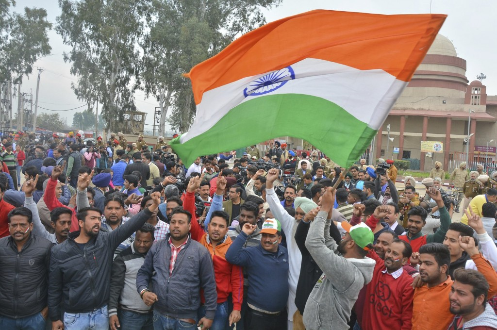 Indians near border of Wagah await the return of the captured Indian pilot