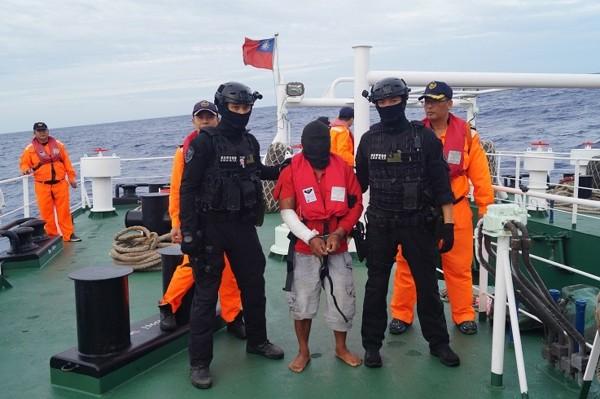 Suspect (center).
