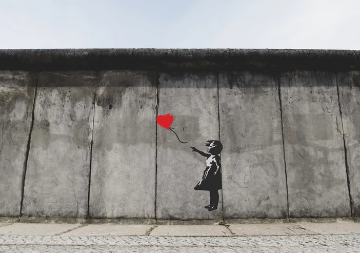 Banksy's Girl with Balloon (Photo by unsplash user Eric Ward)