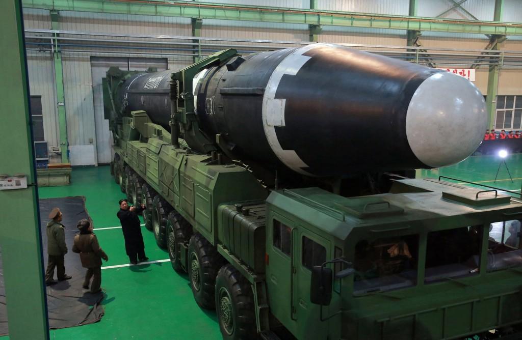 File photo: Kim Jong Un inspects missile
