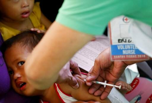 Child in Philippines receives measles vaccine