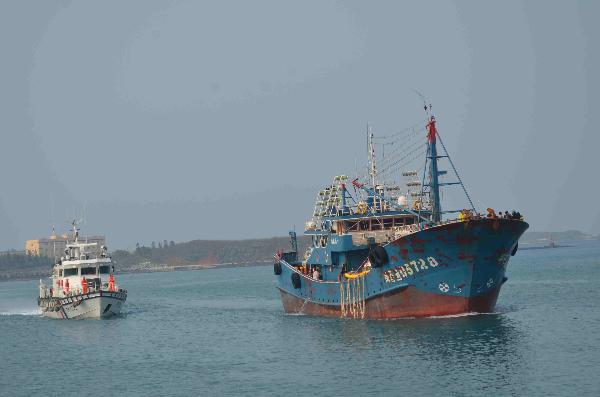 Taiwan Coast Guard escorts the commandeered Chinese vessel