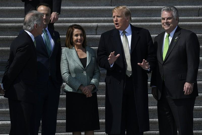 President Donald Trump arrives on Capitol Hill Mar. 14