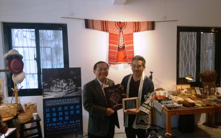 CIP Deputy Minister Calivat Gadu (left) is joined by Mamoru Kaizawa, head of the Ainu association in Nibutani district of Hokkaido's Biratori town, in
