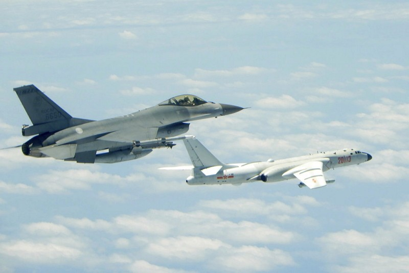 A Taiwanese Air Force fighter aircraft, left, flies near a PLAAF H6-K bomber that reportedly flew over the Luzon Strait south of Taiwan during an exer