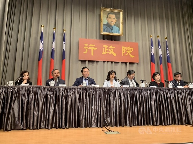 Cabinet members explaining new government measures Thursday.