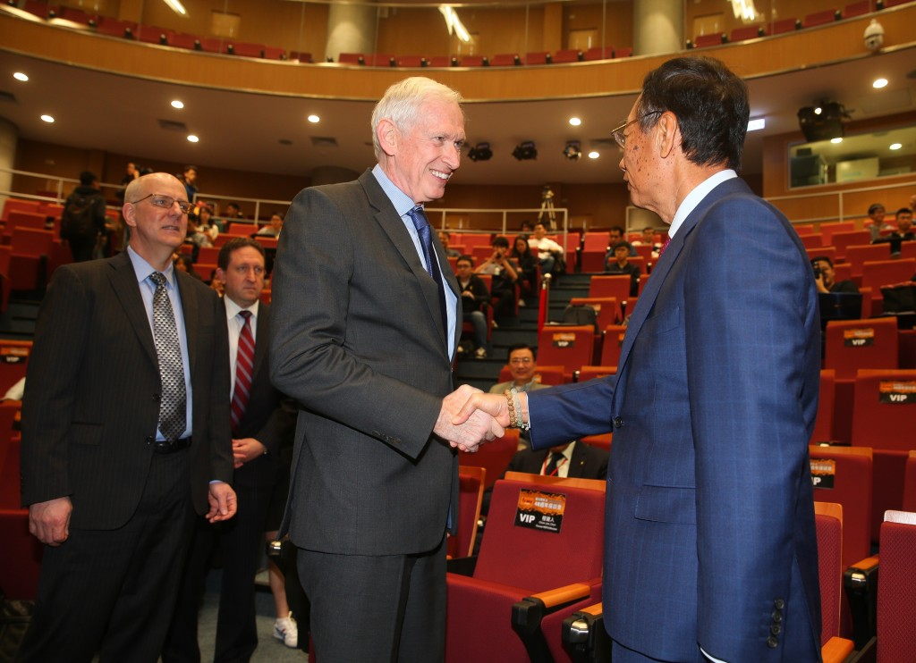 AIT Chairman James Moriarty shakes hands with Foxconn CEO Terry Gou