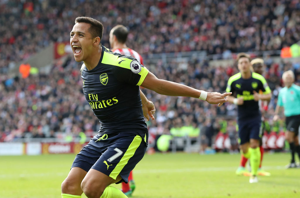 Arsenal's Alexis Sanchez celebrates scoring his side's first goal of the game during their English Premier League soccer match against ...