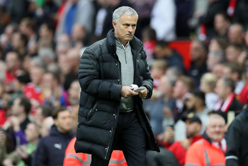Manchester United manager Jose Mourinho heads back down the tunnel at half time during their English Premier League soccer match agains...