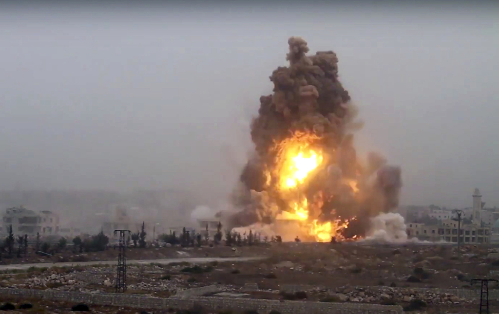 This frame grab from video provided by Thiqa news agency, a Syrian opposition media outlet that is consistent with independent AP repor...