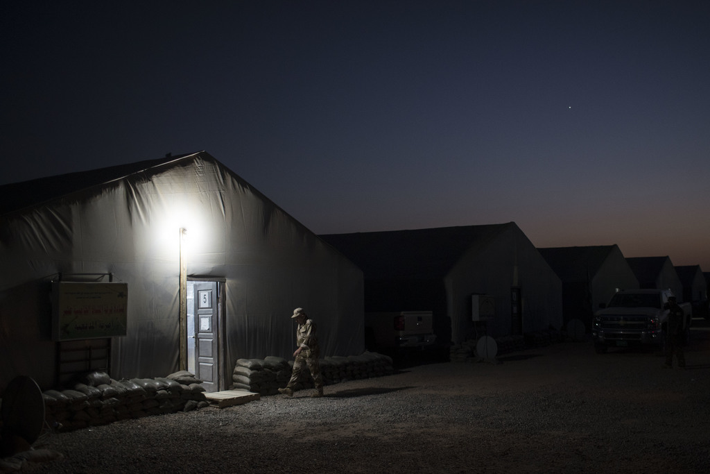 An Iraqi army soldier walks to a tent at the Qayara air base, south of Mosul, Iraq, Monday, Oct. 31, 2016. For two weeks, Iraqi forces ...