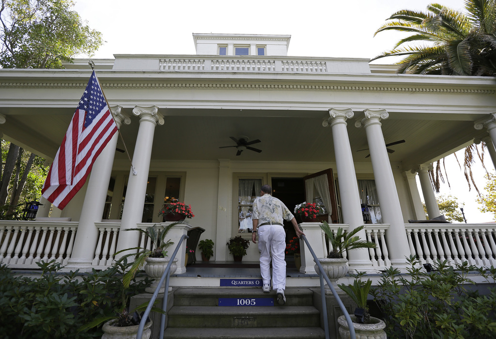 In this photo taken Friday, Oct. 7, 2016, a man makes his way up steps to the Vino Godfather winery on Mare Island in Vallejo, Calif. T...