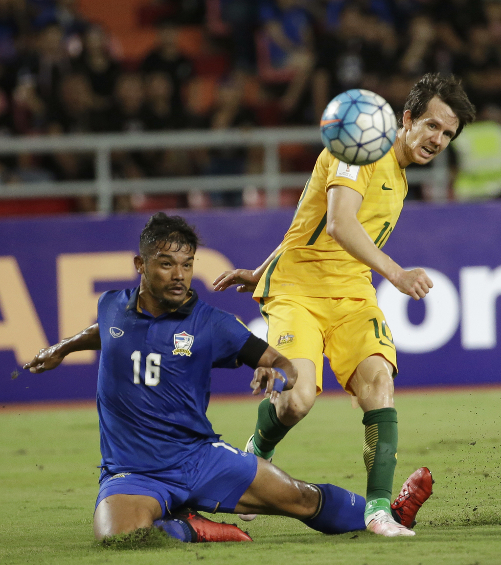 Pratum Chuthong of Thailand, left, and Robbie Kruse of Australia battle for the ball during their 2018 World Cup qualifier soccer match...
