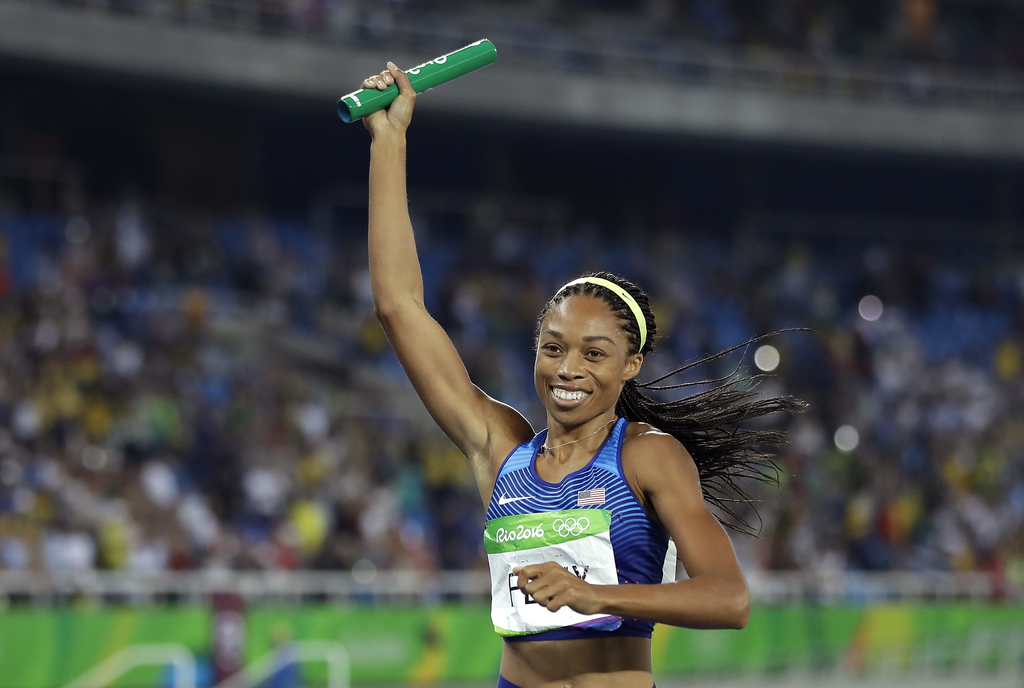 FILE - In this Aug. 20, 2016, file photo, United States' Allyson Felix celebrates after winning the gold medal in the women's 4x400-met...