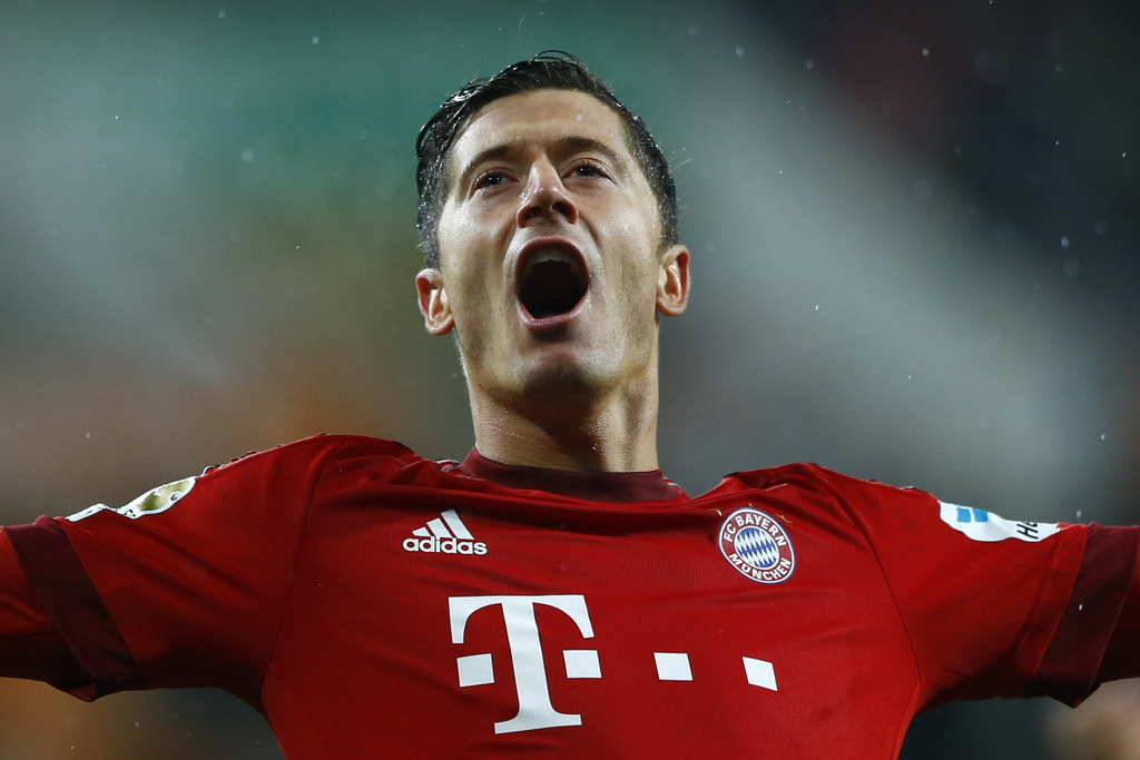 FILE - In this Feb. 14, 2016 file picture Bayern's Robert Lewandowski celebrates after scoring his side's second goal during the German...