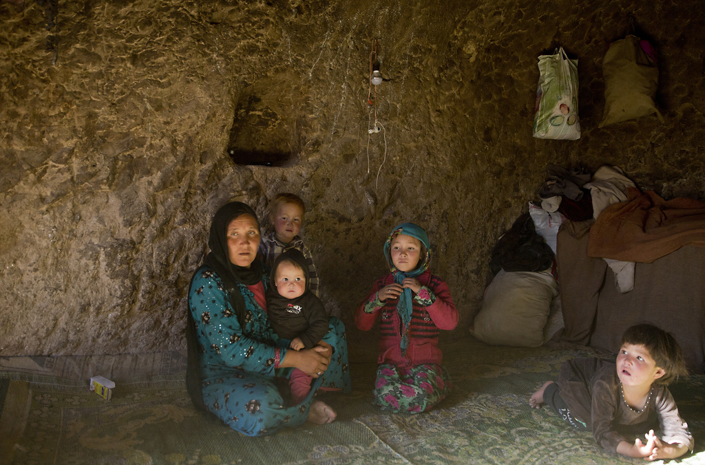 In this Monday, Nov. 7, 2016 photo, Marzia, 30, talks during an interview with the Associated Press in her cave in Bamiyan, Afghanistan...