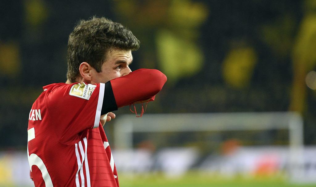 Bayern's Thomas Mueller reacts after losing the German Bundesliga soccer match between Borussia Dortmund and Bayern Munich in Dortmund,...