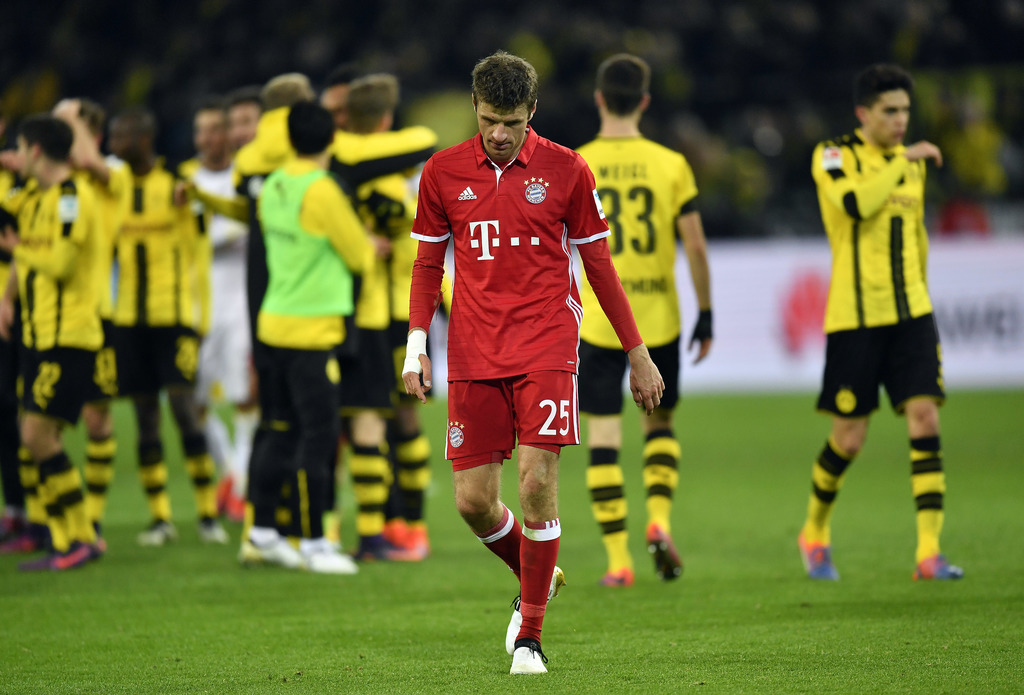 Bayern's Thomas Mueller leaves the pitch after losing the German Bundesliga soccer match between Borussia Dortmund and Bayern Munich in...