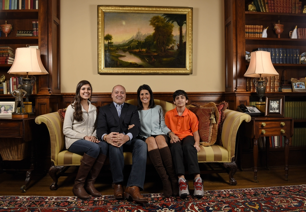 In this Jan. 8, 2015 photo, South Carolina Gov. Nikki Haley along with her family, husband Michael, daughter Rena, and son Nalin sit fo...