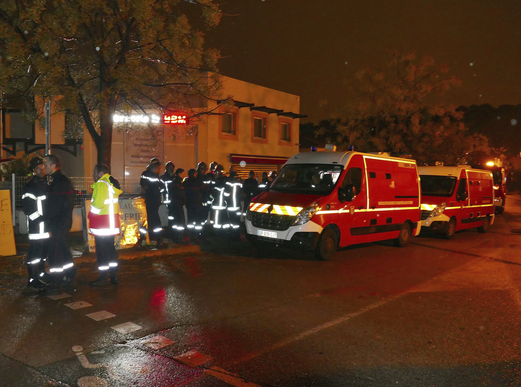 Firefighters and ambulances are seen in the village of Montferrier-sur-Lez, southern France, Friday, Nov. 25, 2016. The French gendarme...