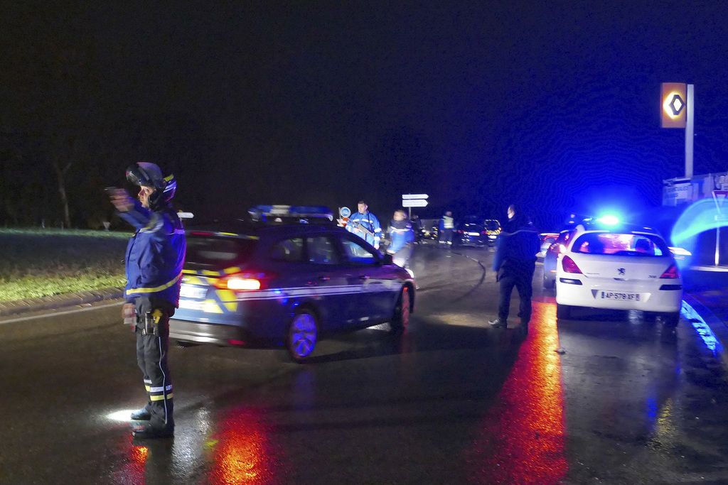 French Gendarmes control cars near the village of Montferrier-sur-Lez, southern France, Friday, Nov. 25, 2016. The French gendarmerie s...